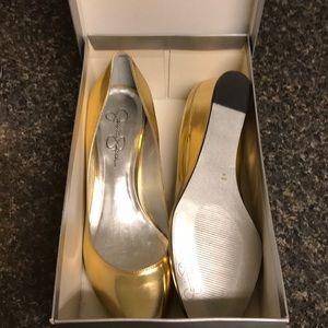 Size 10 new in box Jessica Simpson gold pumps